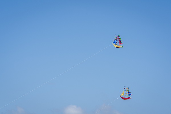 Kites In The Clear Sky Of Bali Photograph by Mauro Tandoi