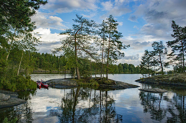 Lake with trees and rocks in the Dalsland Lake District in Sweden. Photograph by Sjo