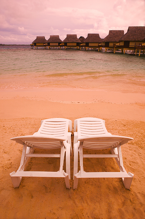 Landscape Photograph Of Two Empty Beach Chairs Overlooking A Beautiful Beach And Resort Photograph by Photodisc