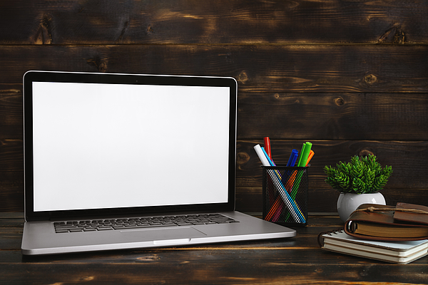 Laptop with Blank White Screen Against Rustic Wood Background. Screen Mock Up. Photograph by Constantine Johnny