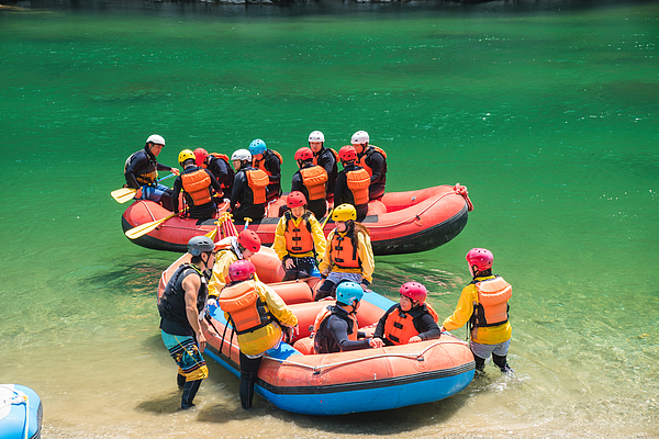 Large group of men and women boarding rafts to go white water river rafting Photograph by Tdub303
