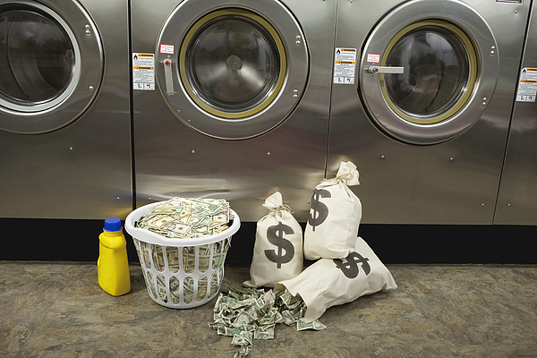 Laundering Money Photograph by Jtyler