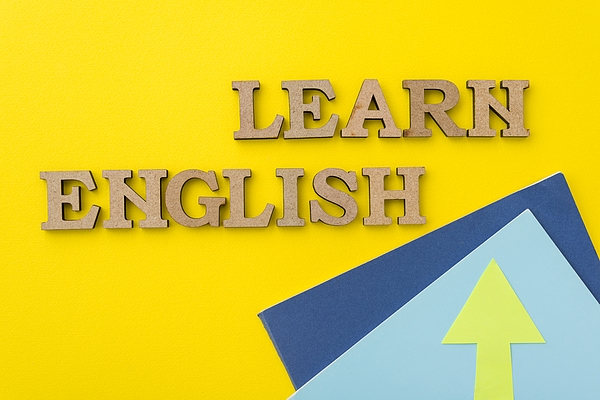 Learn English, Words In Wooden Letters With Yellow Background Photograph by Valeriy_G