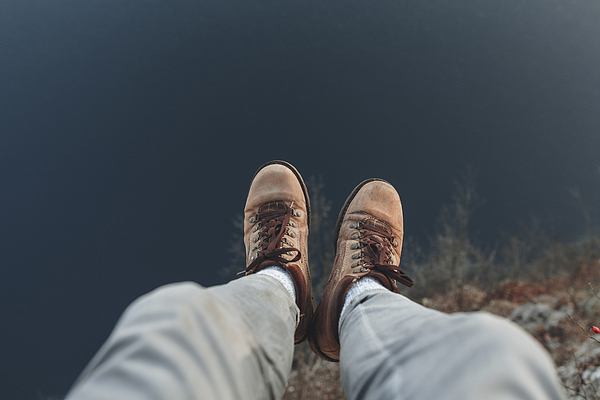 Legs of Caucasian man sitting at the edge of reservoir Photograph by Mykhailo Lukashuk