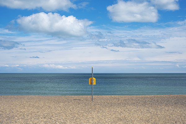 Life Bouy on empty beach on Irelands East Coast Photograph by Catherine MacBride
