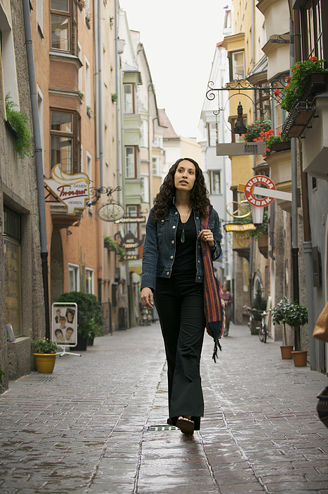 Lifestyle Portrait Of A Young Adult Woman As She Goes Sightseeing While Visiting Europe Photograph by Photodisc