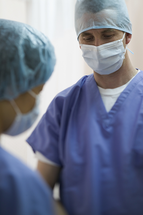 Lifestyle Portrait Of Two Adult Surgeons As They Gather Together For An Operation Photograph by Photodisc