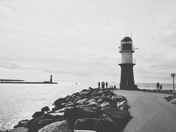 Lighthouse On Pier At Sea Against Sky Photograph by Fabian Schultz / EyeEm