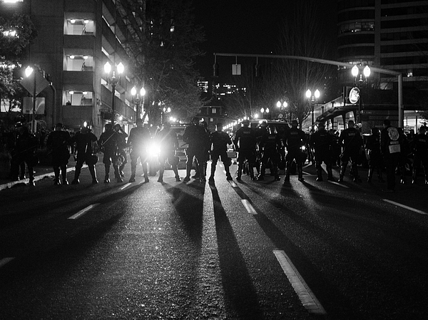 Line of police officers in riot gear Photograph by Ivan McClellan