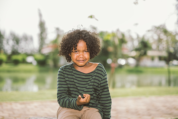 little African american boy crying Photograph by Pondsaksit