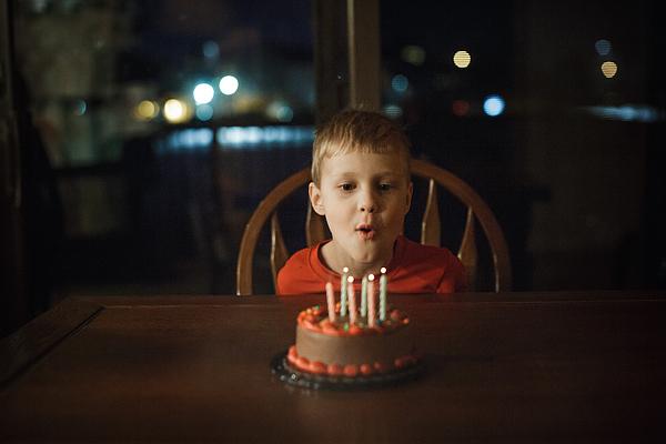 Little blowing out candles Photograph by Annie Otzen