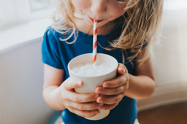 Little girl drinking a Cup of Milk with a Paper Straw Photograph by Catherine Falls Commercial