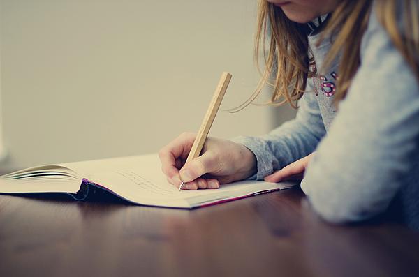 Little girl writing Photograph by SVGiles