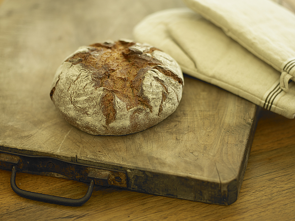 Loaf Of Bread On Butchers Block Photograph by T&I studio