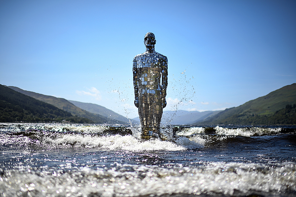 Lochs Mirror Man Rises For The Summer Photograph by Jeff J Mitchell