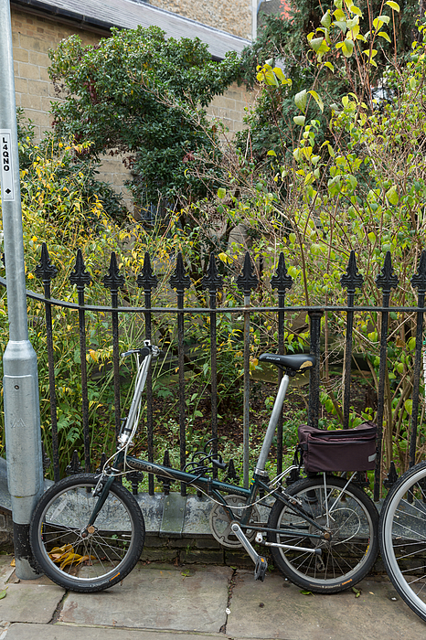 locked bicycle in the city centre of Cambridge England Photograph by Mikeuk