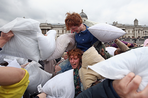 Londoners Participate In World Pillow Fight Day In Trafalgar Square Photograph by Dan Kitwood