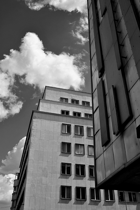 Low Angle View Of Buildings Against Cloudy Sky Photograph by Dariusz Sobiecki / EyeEm