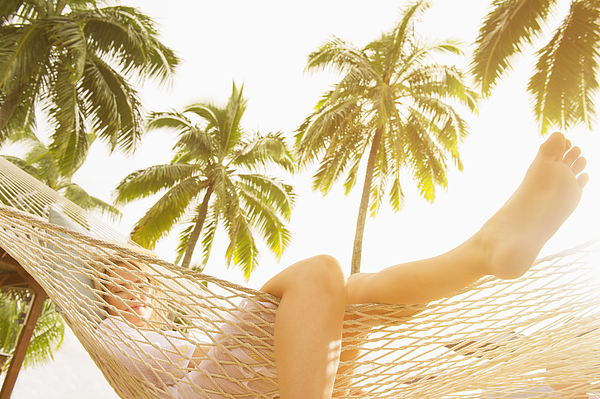 Low angle view of Caucasian woman laying in hammock Photograph by Jacobs Stock Photography Ltd