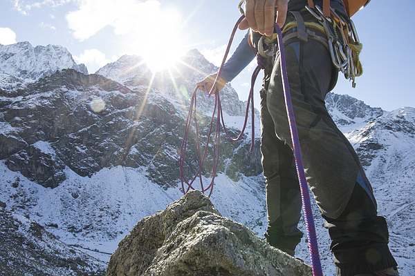 Low Angle View Of Mountain Climber With Rope In Mountains Photograph by AscentXmedia