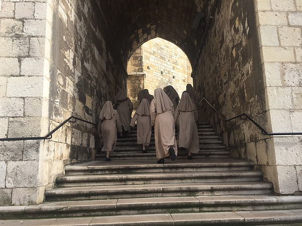 Low Angle View Of Nuns Walking Up Stairs Photograph by Luis Colmenero / EyeEm