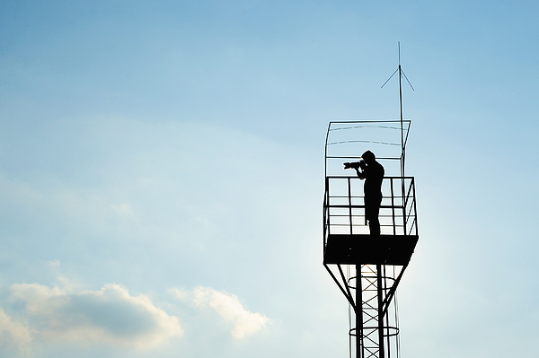 Low Angle View Of Silhouette Man Standing In Lookout Tower Against Sky Photograph by Piotr Hnatiuk / EyeEm
