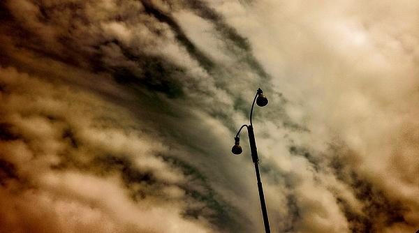 Low Angle View Of Silhouette Street Light Against Cloudy Sky Photograph by Guglielmo Enea / EyeEm