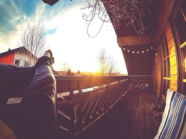 Low Section Of Man Relaxing In Balcony Photograph by Jose Atencia / EyeEm