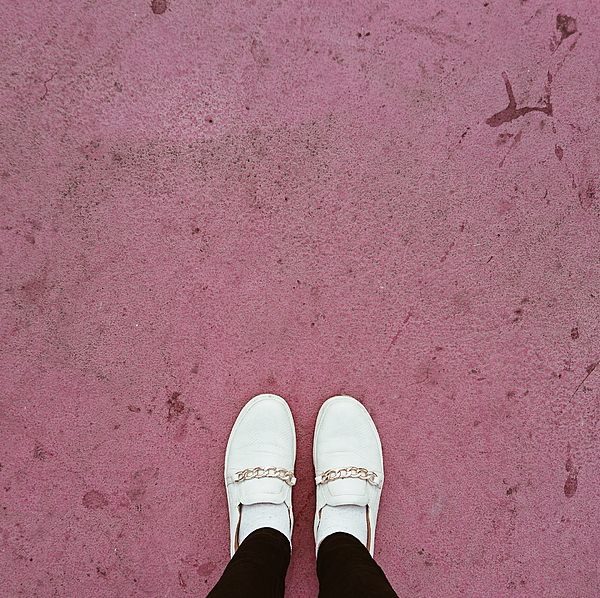 Low Section Of Woman Standing On Pink Footpath Photograph by Dariana Oleinik / EyeEm
