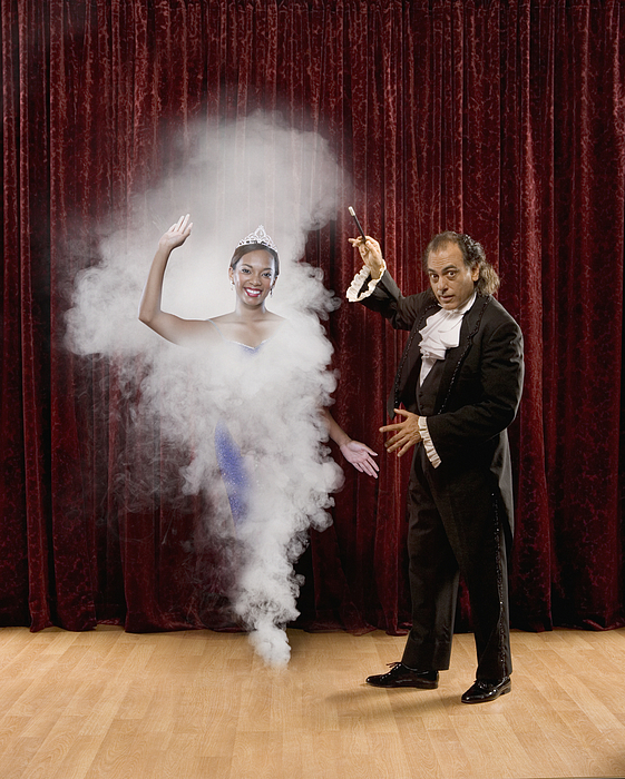 Magician making woman appear out of thin air Photograph by John M Lund Photography Inc
