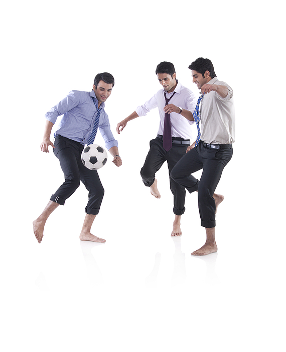 Male executives playing soccer Photograph by Sudipta Halder