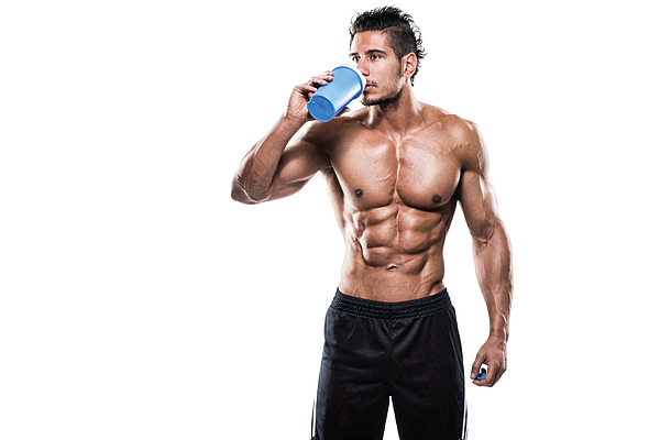 Male fitness athlete drinking protein shake Photograph by Extreme-photographer