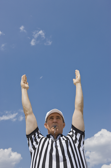 Male football referee making touchdown call Photograph by Tetra Images