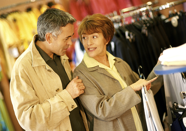 Man and woman in clothing store, waist up. Photograph by Eric Audras
