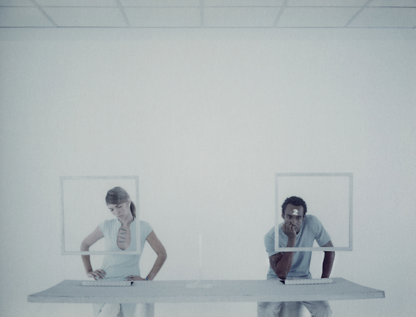 Man And Woman Sitting At Desk Photograph by Matthieu Spohn