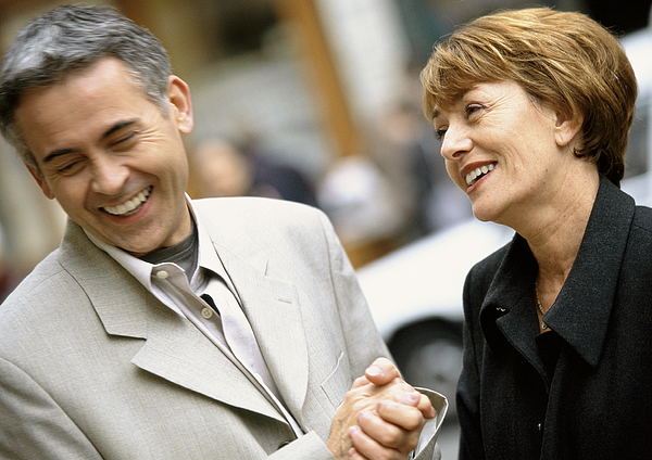 Man And Woman Standing Laughing Together, Woman Looking At Man, Close Up. Photograph by Eric Audras