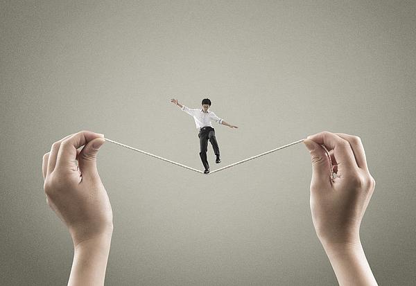 Man balancing on the rope Photograph by Yagi Studio