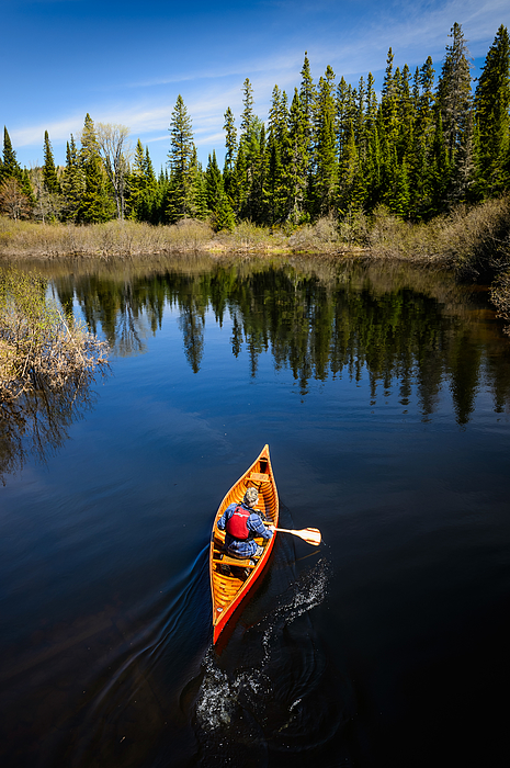 Man canoeing on the river Photograph by Max shen
