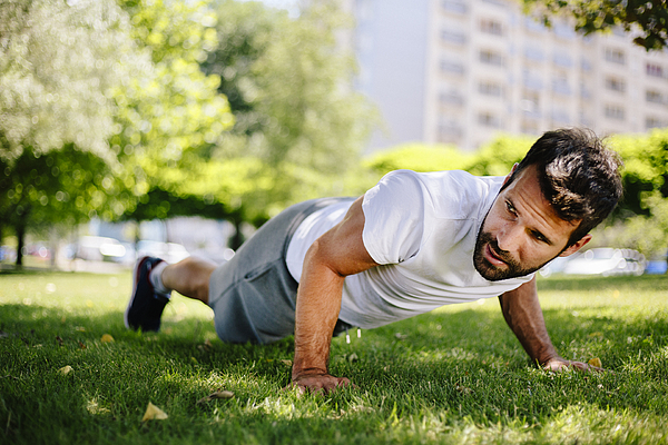 Man doing pushups in nature Photograph by Milanvirijevic