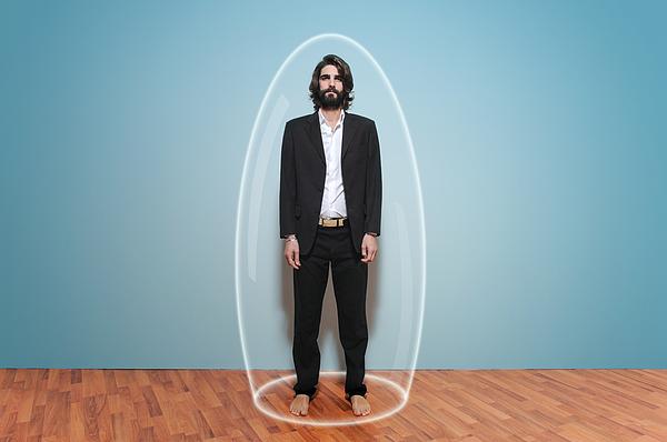 Man inside a large glass test tube Photograph by Francesco Carta fotografo