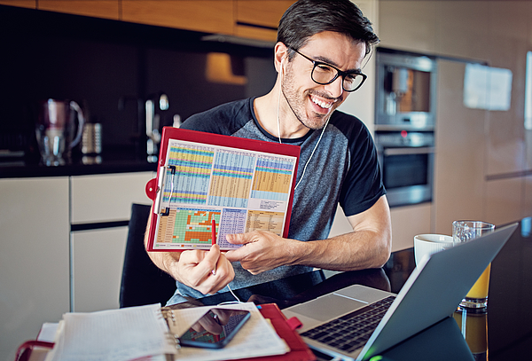 Man is working at home and video conferencing using his laptop Photograph by Praetorianphoto