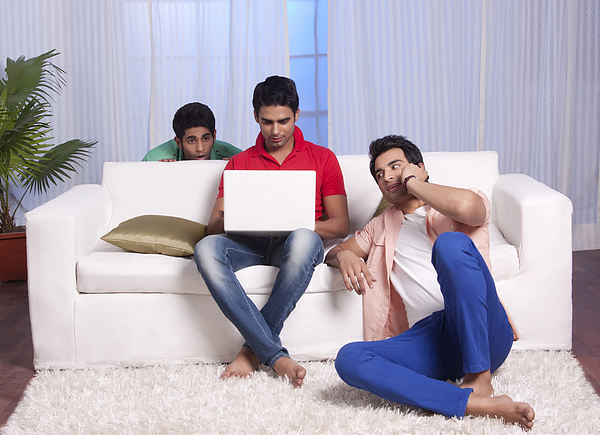 Man peeping into his friends laptop Photograph by Sudipta Halder