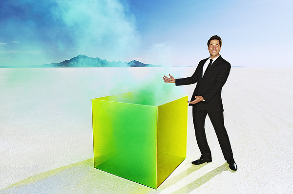 Man presenting smoking box in desert. Photograph by Andy Ryan