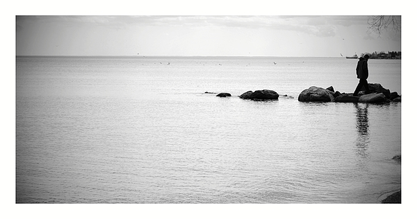 Man Walking On Rocks Over Sea At Beach Photograph by Hanna Koper / EyeEm