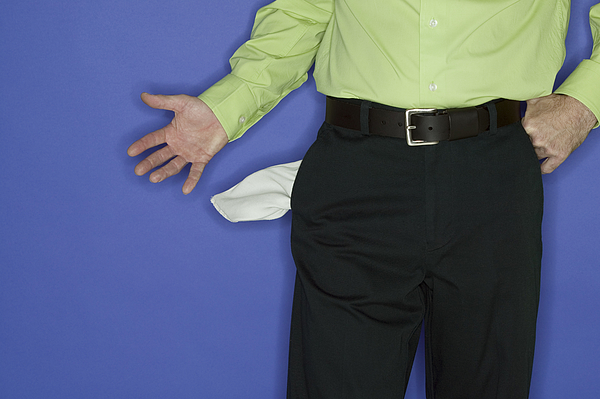 Man With An Empty Pockets Photograph by Comstock Images