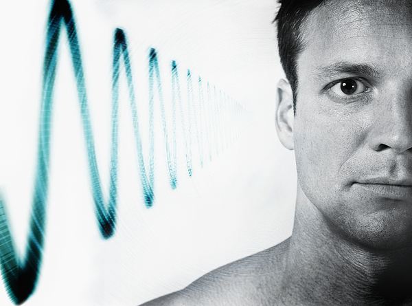 Man with soundwave at side of head (Digital Composite) Photograph by Adam Gault