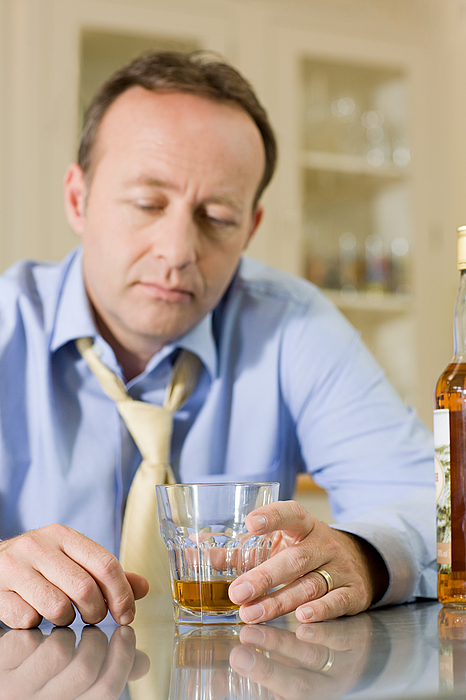 Man with whisky Photograph by Image Source
