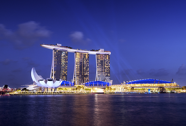 Marina Bay Sands Light & Water Show Photograph by Bernd Schunack