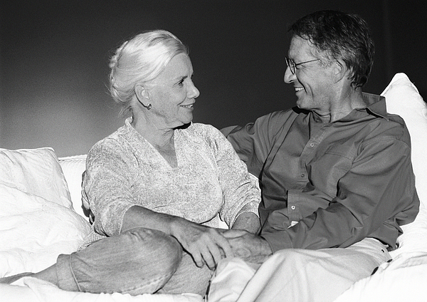 Mature Couple Sitting On Couch, B&w Photograph by Teo Lannie