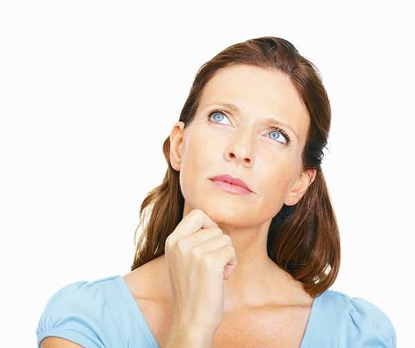 Mature woman, deep in thought Photograph by GlobalStock